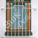 Fenstergitter aus Eisen geschmiedet altweiß bemalt und vergoldet