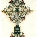 Grabkreuz aus Eisen geschmiedet, farblich bemald und vergoldet