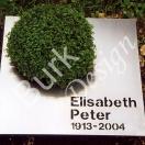 Urnengrab - Grabmal aus Edelstahl mit Schrift und Bepflanzung